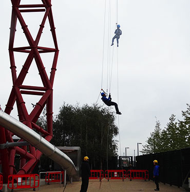 Abseiling down the orbit in London's Olympic Park.