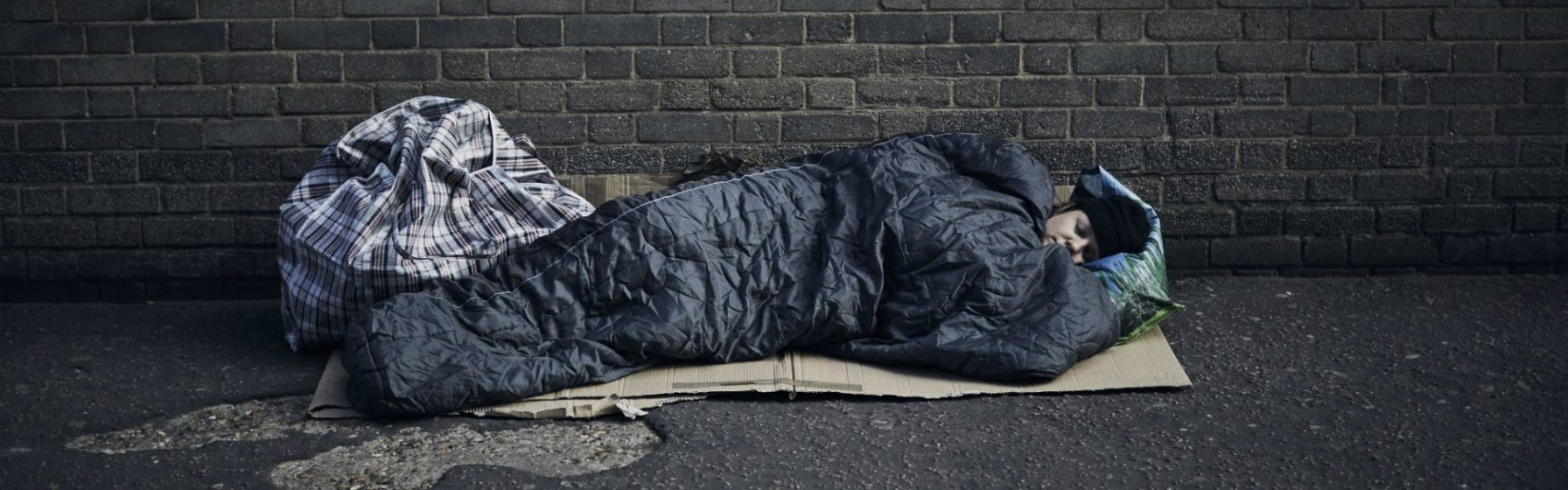 image: person sleeping rough