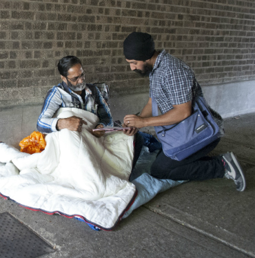 Outreach worker with rough sleeper