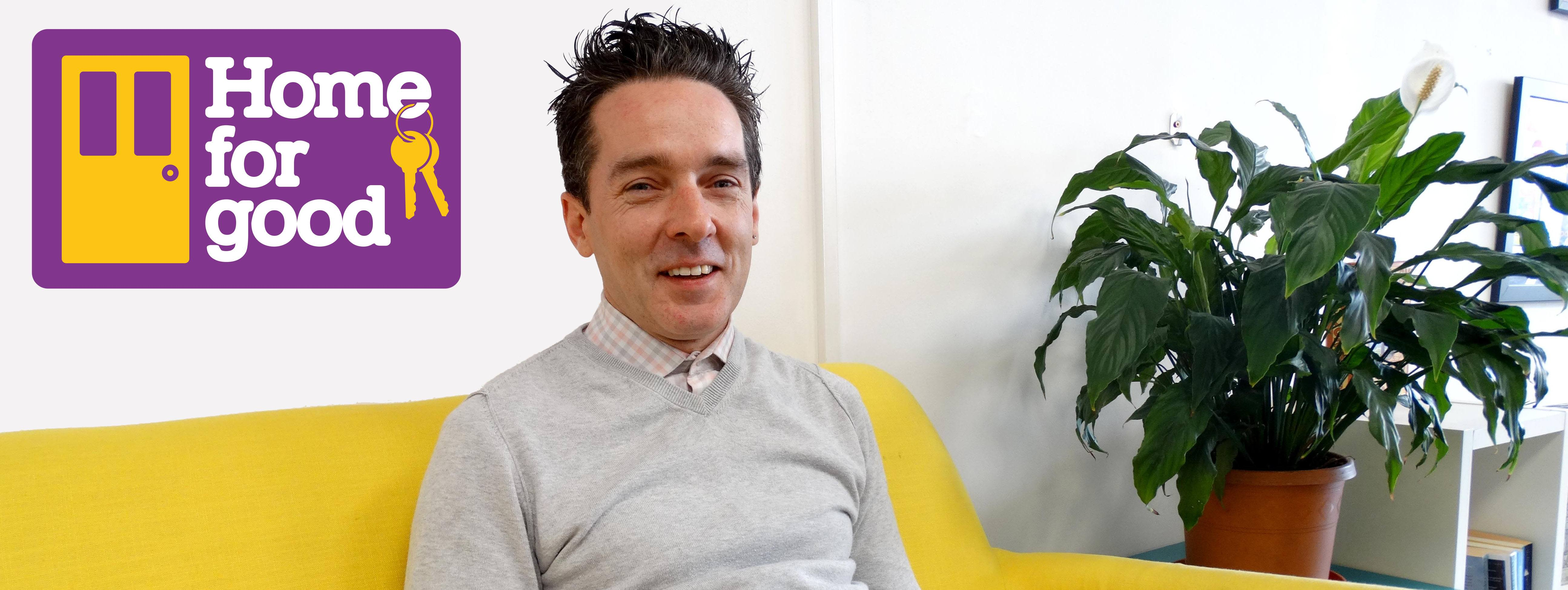 Kevin on his sofa with the Home for Good campaign logo