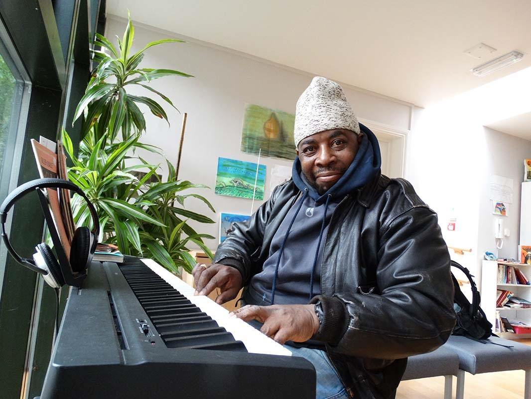 Image: client playing piano